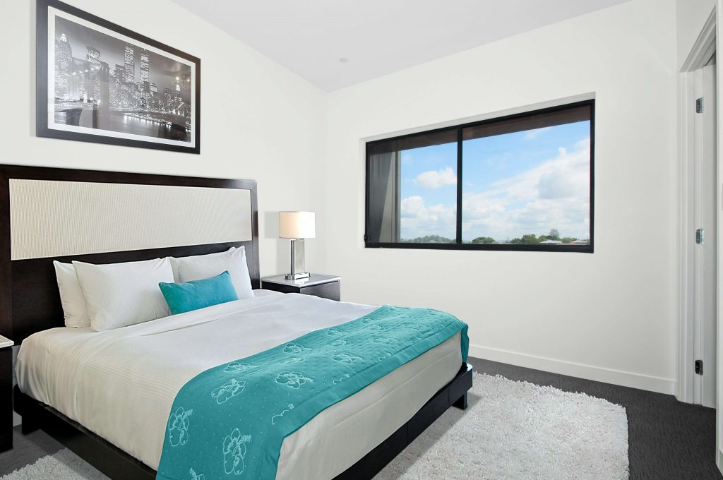 Inside of an apartment bedroom, group investing in an apartment complex for passive income