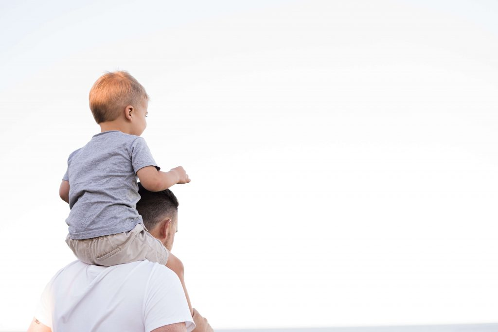 Generational wealth, man holding his son on his shoulders