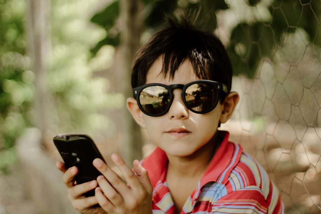 Child with a cell phone, how to protect your multi generational wealth